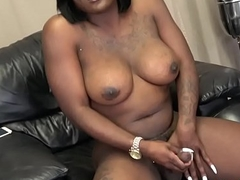 Nubian ts beauty stroking her broad in the beam cock